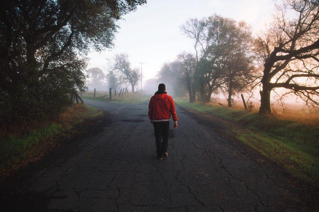 man walking road of decision